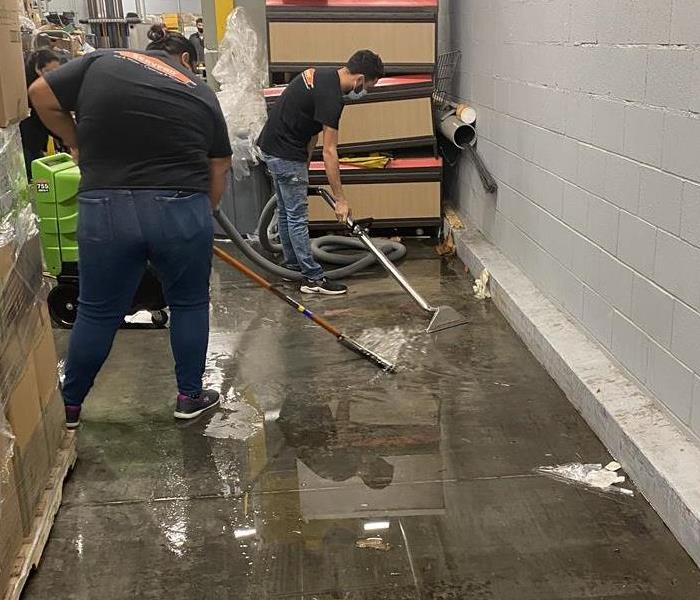 SERVPRO workers removing water from area to begin drying process