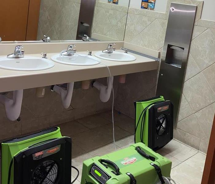 Green specialized equipment is placed in bathroom
