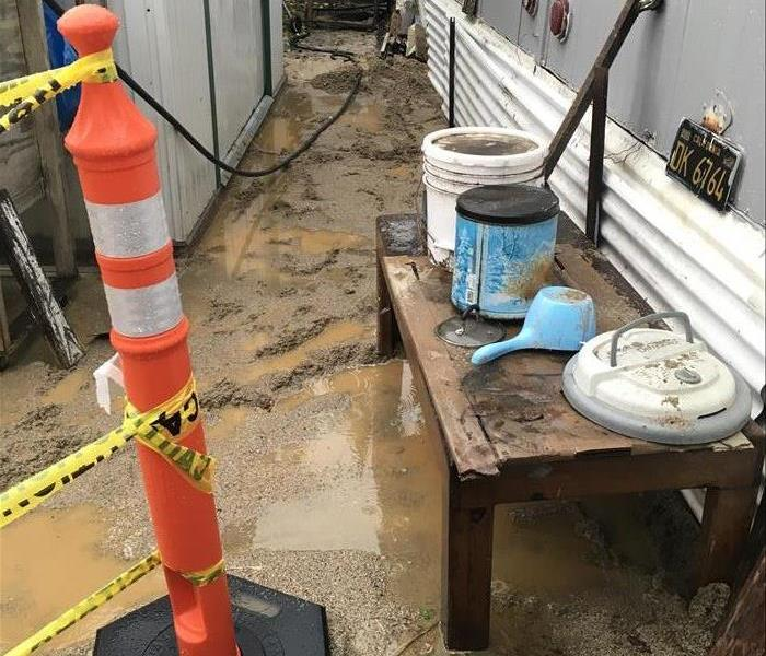 A sewage backup began to contaminate the outside of this Westminster home, but it then worsened because of the rainy season.