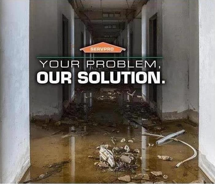 Building with water damage and SERVPRO logo
